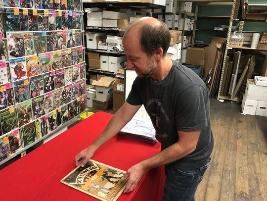 Chris Rupp of Rupp's Comics shows off a Detective Dan