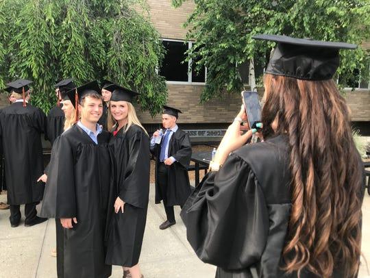 Lillia Beckmann takes a photo of classmates Grace Eichinger