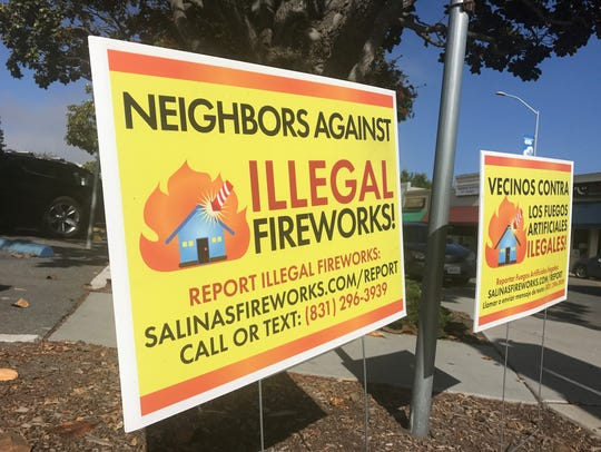 A sign advertising how to report illegal fireworks