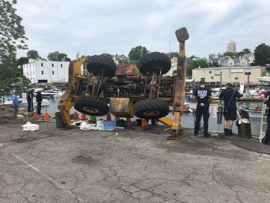 No one was injured after a crane toppled over in Hudson