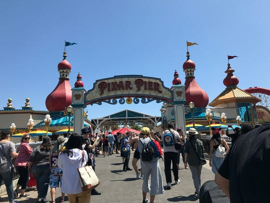 A dazzling marquee welcomes guests to Pixar Pier which