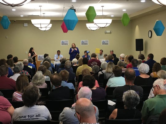 Kelda Roys, standing, a Democratic candidate for governor, speaks during the Citizen Action of Wisconsin forum Saturday at the Kress Family Branch of the Brown County Library in De Pere.