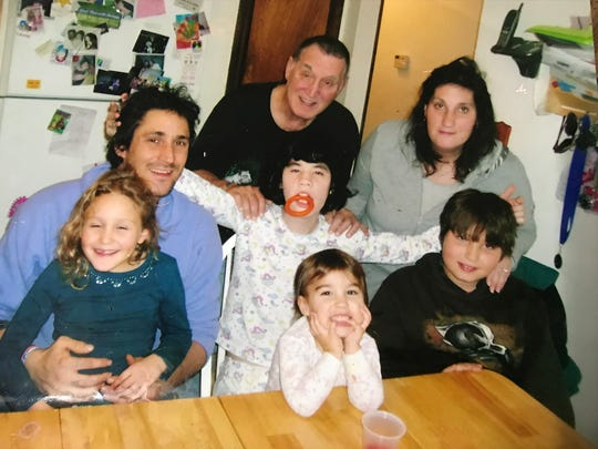 Willow and Jeff Goldberg are in blue with Jeff's sister Laurie Gould and her family in an undated photo taken before 2008.