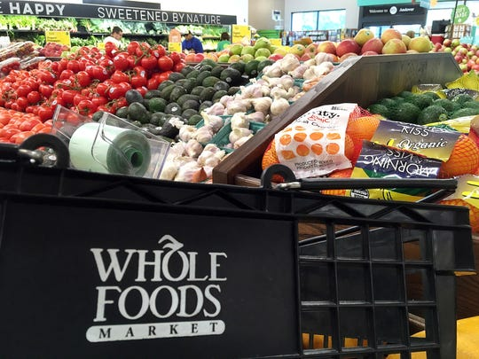 This June 5, 2017, photo, shows produce displayed at Whole Foods Market in Andover, Mass.