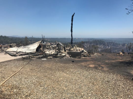 Cal Fire officials said four structures were destroyed in the Creek Fire on Sunday.