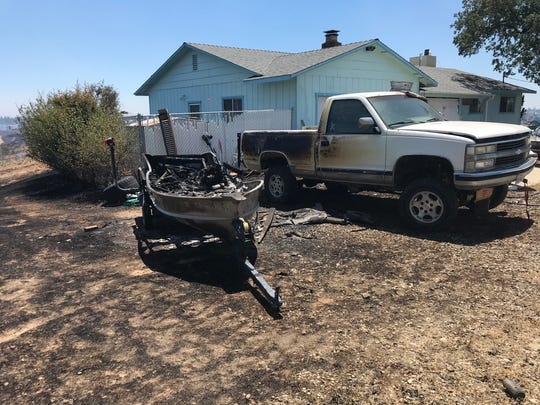 A boat and pickup were damaged in the Creek Fire on Sunday.
