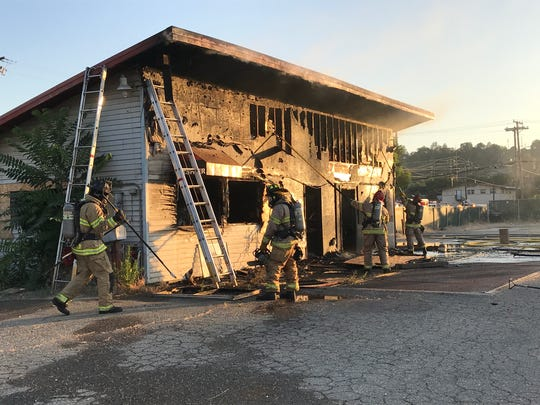 Redding firefighters put out a fire at a vacant commercial building that caught fire Monday, June 25, 2018 on Ellis Street.