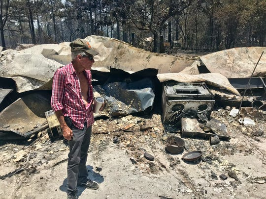 Jimmy Boone, a retired oysterman and truck driver, surveyed his razed mobile home on Monday afternoon. Boone lived at the trailer on Wilderness Road for 41 years.