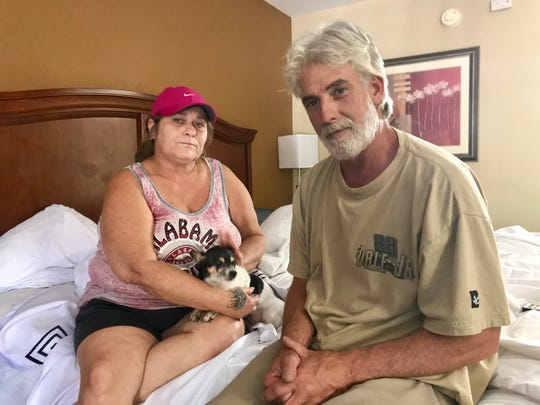 Arlene Thompson, her partner Robert Schmidt and their Chihuahua barely escaped a forest fire Sunday in Eastpoint. They're staying in a motel for the time being.