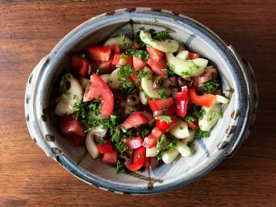 This cucumber-tomato salad makes use of ingredients the campers might harvest at a local farm they visited.