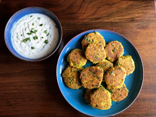 Falafel with yogurt sauce is a good, healthful recipe for kids to make.