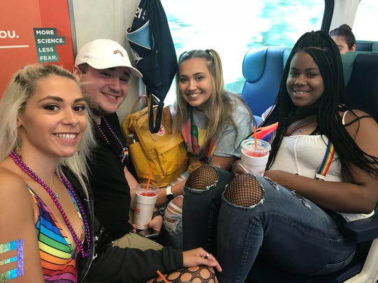 Saige Lopez, Jake Pabst, Sarah Mirisola and Brianna Rainey, from right to left, commuted into Grand Central Terminal via the Harlem Line on Sunday for New York City Pride.