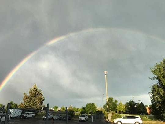 A rainbow appeared over Great Falls Monday night after