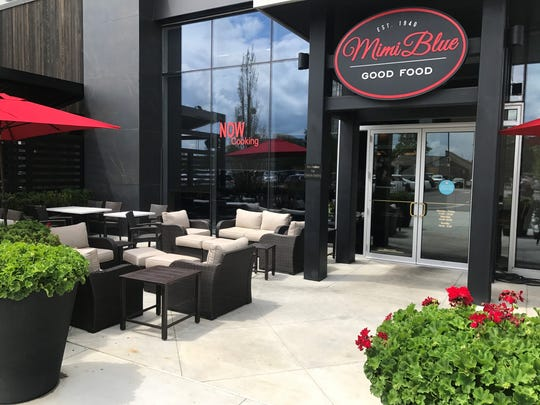 Comfortable couches and umbrella tables furnish the patio at Mimi Blue Meatballs location at The Fashion Mall on the north side of Indianapolis.