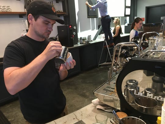 Prevail Union founder Wade Preston makes an espresso