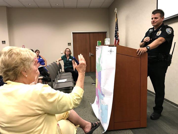Sue Lang, a downtown neighborhood resident, asks Redding
