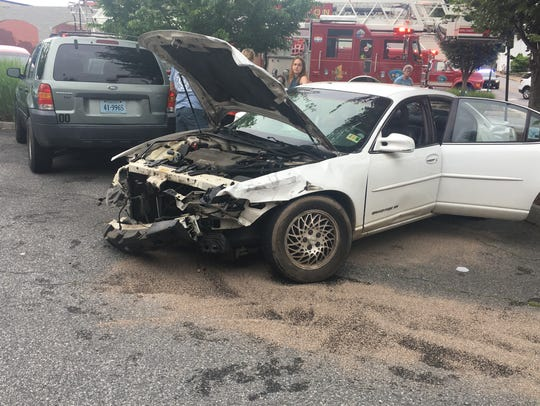 Pictured is a car damaged Tuesday in Staunton after