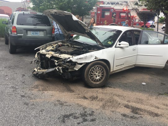 Pictured is a car damaged Tuesday in Staunton after the driver went the wrong way on a one-way street, police said.