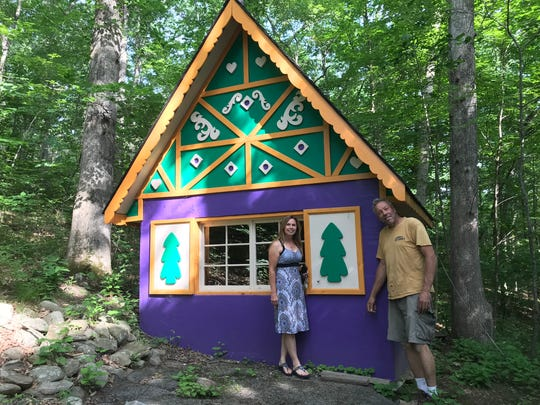 Park owner Christine Vander Ploeg and Vernon-based contractor Robert Bernet stand in front of Pinocchio's cottage at Fairy Tale Forest on June 26, 2018. The theme park in West Milford, N.J. could reopen later in 2018.