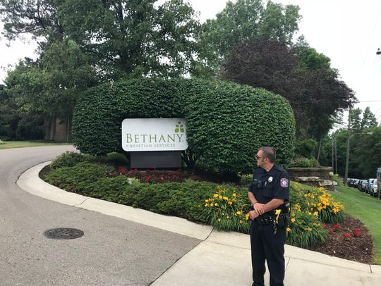 A police officer stands at the  entrance to Bethany