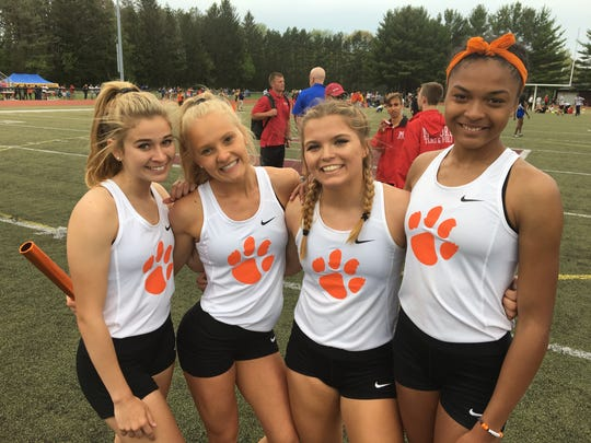 Brighton's 400- and 800-meter relay teams consisted of (from left) Kennedy Smith, Maddie Vernon, Felesity Norris, and Brooke Gray.