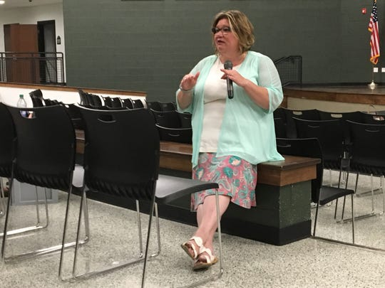 Madison Superintendent Shelley Hilderbrand speaks with parents and residents after a school board meeting Tuesday, July 26, 2018.