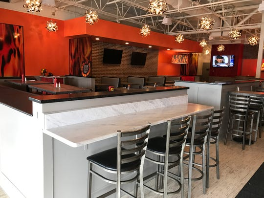 A mouth-watering, smoky aroma perfumes the dining room at Flamme Burger's Keystone Commons location, 8487 Union Chapel Road, near The Fashion Mall. The restaurant opened June 20, 2018.