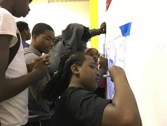 Students sign the anti-gun pledge at the Boys and Girls