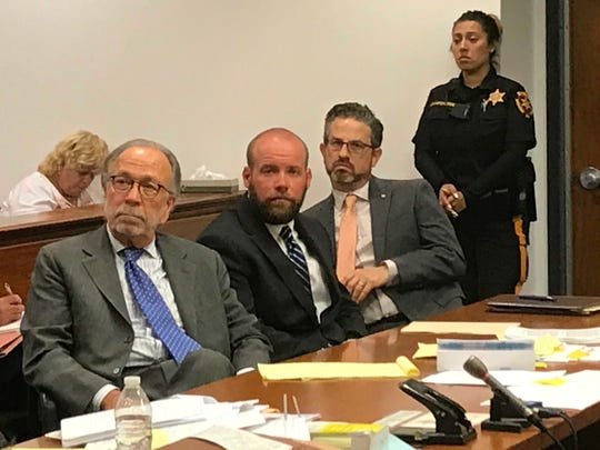 Jake Pascucci sits in between his two defense attorneys during his sentecing on a vehicular homicide charge on June 28, 2018.