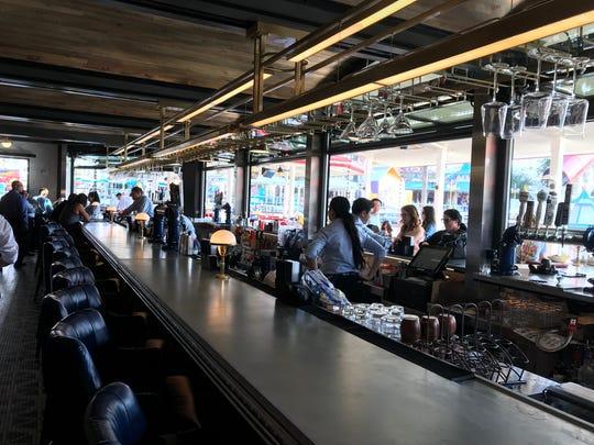 Take a seat at the Lamplight Lounge bar at Pixar Pier