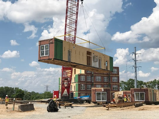 Alloy is the first modular development in Nashville. Condos were built out of state and shipped fully furnished. Then they were stacked.