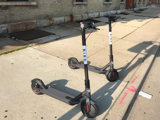Bird scooters are parked in the Walker's Point area