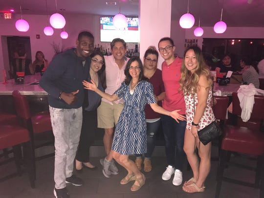 "Jeanne Muchnick, food and dining reporter for lohud, center, with ""Dinner with Jeanne"" guests at Don Coqui On The Hudson in Haverstraw. Photographed June 27, 2018"