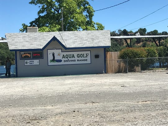 Among the mishmash of development along the Sacramento River is Aqua Golf, a driving range that allows golfers to tee off into the water.