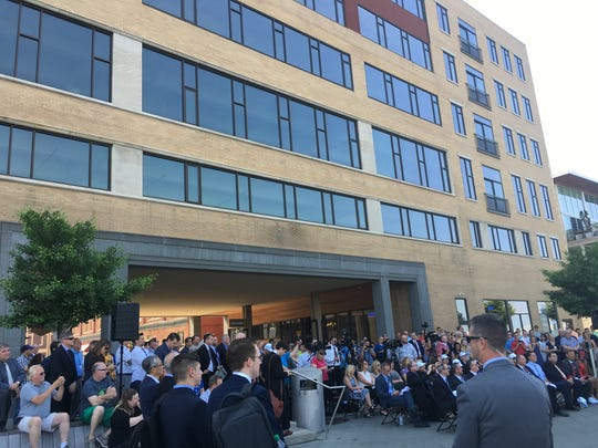 A gathering at The Watermark in downtown Green Bay for Foxconn's announcement Friday morning that it will buy the building for a regional innovation center.