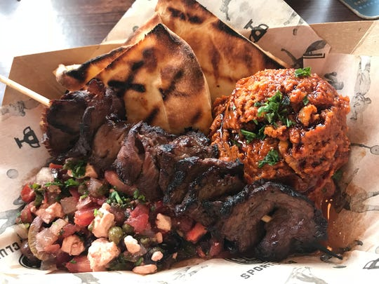 The mezze plate at SportClub with skewered beef, salad,