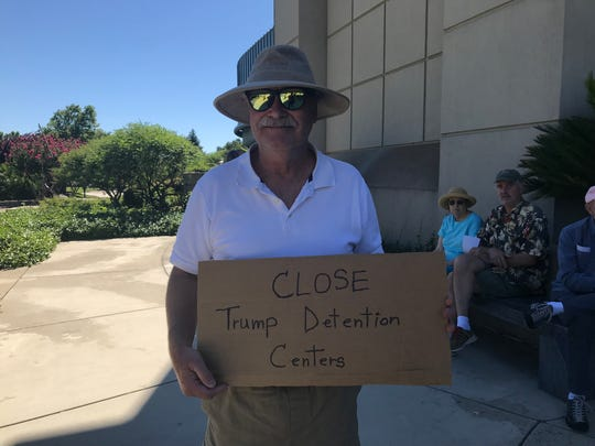 Albert Richmond, 65, brought a sign to Saturday's march.