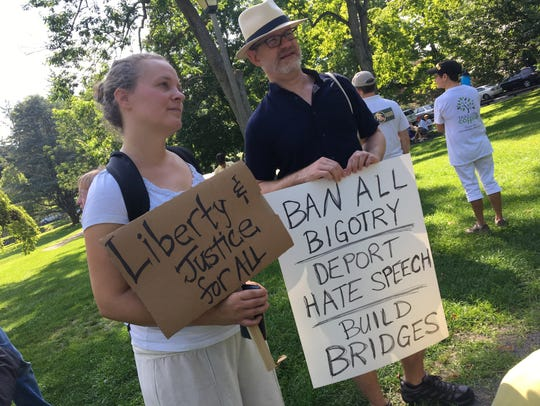 Participants at the Families Belong Together March at Staunton's Gypsy Hill Park on Saturday, June 30, 2018. From left to right: Camille Freeman and Mike Davis.