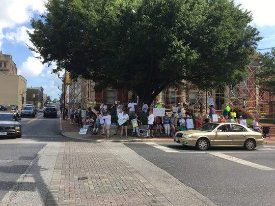 More than 30 people gathered at the Augusta County Courthouse as marchers reached them during the Families Belong Together March in Staunton on Saturday, June 30, 2018.