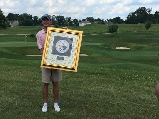Will Grimmer won the Tony Blom Metropolitan Amateur championship July 1, 2018 at Triple Crown Country Club. The 18th green is behind him.