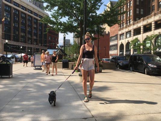 636660652615918189-Woman-walks-dog.jpg