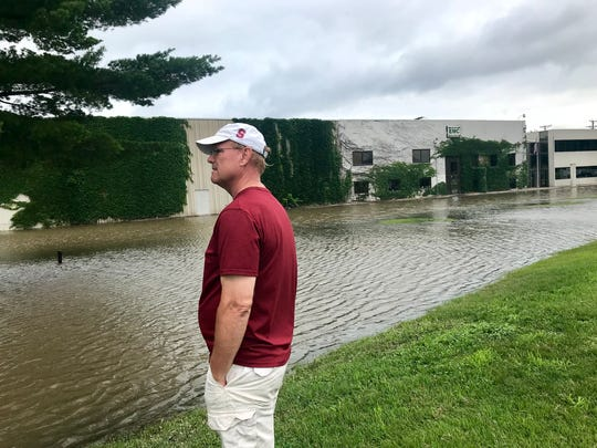 Kris Greenfield, owner of EMC plumbing reviews the damage to his business on Sunday, July 1 following heavy rains Saturday.