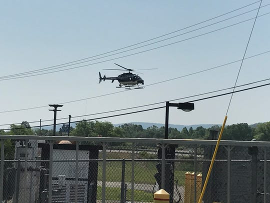 A New York State Police helicopter lands at the trooper