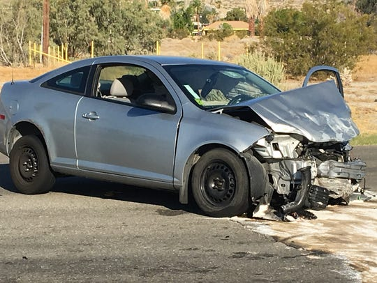 A Chevrolet Cobalt was destroyed in a three-vehicle