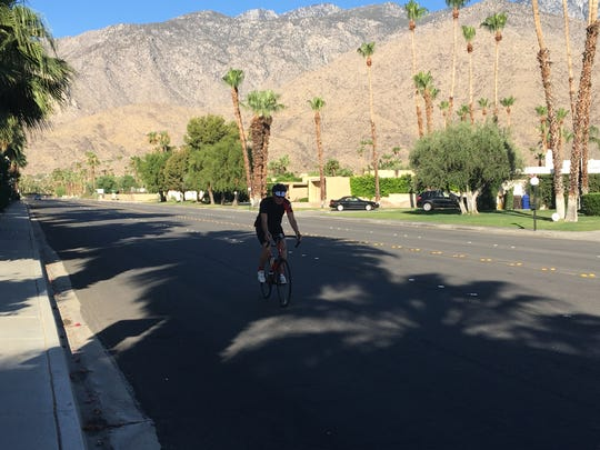 A bicyclist heads north on Laverne Way in Palm Springs.