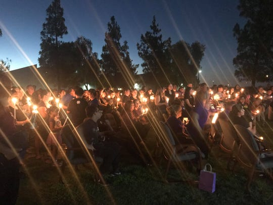 Dozens of mourners lit candles in honor of Edgar during