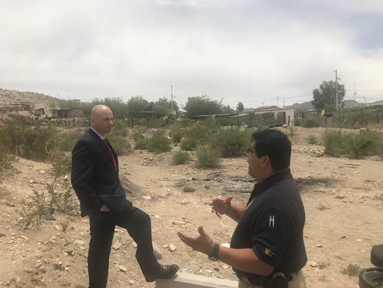 New Mexico Attorney General Hector Balderas (left) talks to Sunland Park Police Department Chief Javier Guerra about border security and immigration issues near the U.S.-Mexico border in Sunland Park.