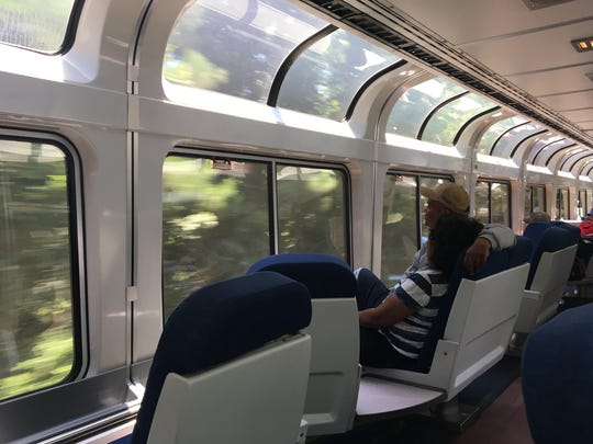 A couple sits in the observation car on Amtrak Train 59 from Jackson to New Orleans on June 29, 2018.