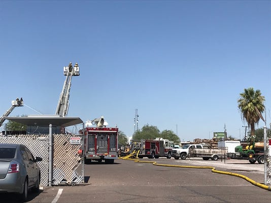 Debris fire at landscaping company in Phoenix