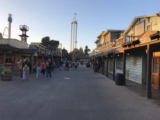 The sun begins to set on the ghost town at Knott's